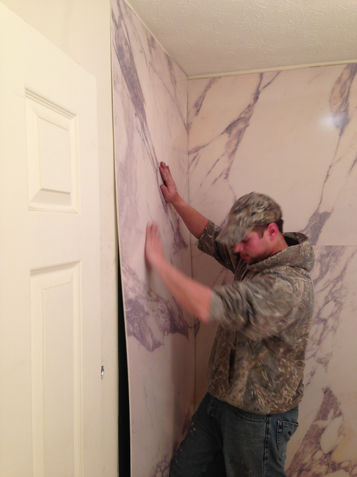 Installing decorative PVC wall panels | Innovate Building Solutions | #PVCPanels #WaterproofPanels #ShowerWallPanels #DIYBathroomPanels