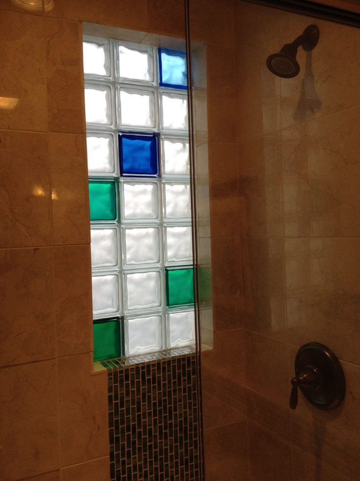 Blue and green colored glass block shower window | Innovate Building Solutions | #ColoredGlassBlock #GlassBlockWindow #BathroomWindow