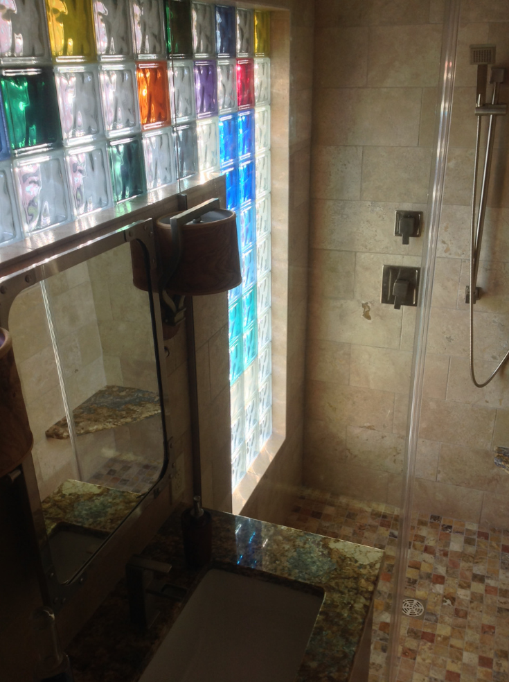 Colored glass blocks in a bathroom shower | Innovate Building Solutions | #ColoredGlassBlock #BathroomWindow #GlassBlockDesign