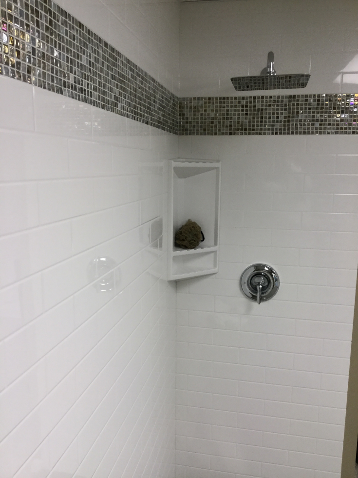 Cultured marble can have a subway tile look pattern | Innovate Building Solutions | #CulturedMarbleShower #BathroomRemodeling #ShowerRemodeling