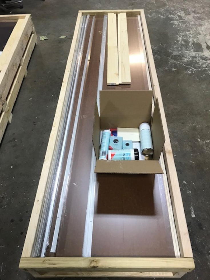 Laminate wall panels a crate ready for shipment with accessories | Innovate Building Solutions | #laminatePanels #BathroomWallPanels #ShippingWallPanels
