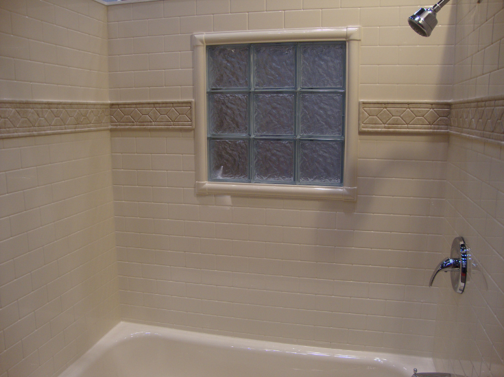 Acrylic shower kit in a subway tile pattern glass block window | Innovate Building Solutions | #AcrylicPans #ShowerBases #BathroomRemodeling