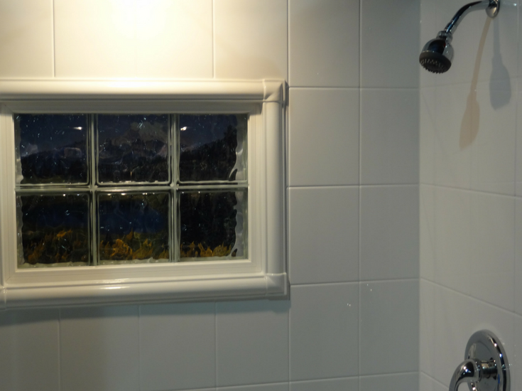 Acrylic window trim kit in a shower with a glass block window | Innovate Building Solutions | #TrimKit #WindowTrim #ShowerWindow