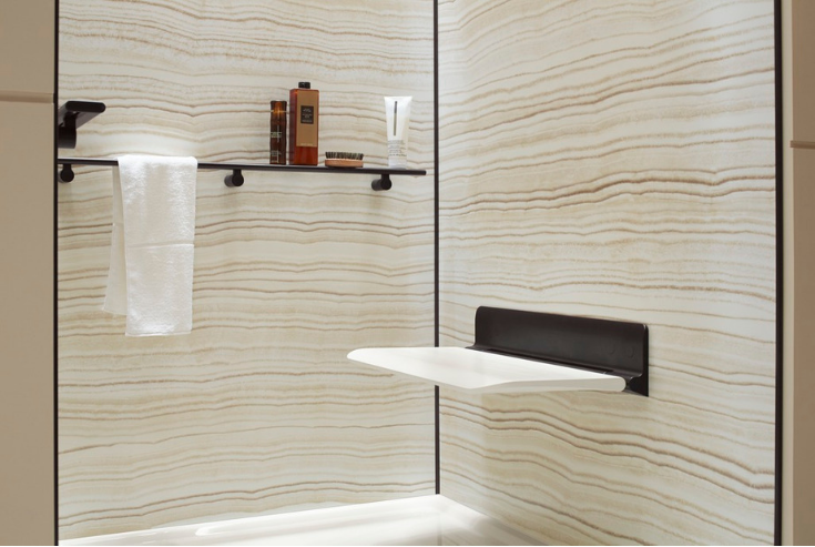 Fold down shower seat for smaller showers | Innovate Building Solutions | #Folddownseat #ShowerSeat #BathroomBench