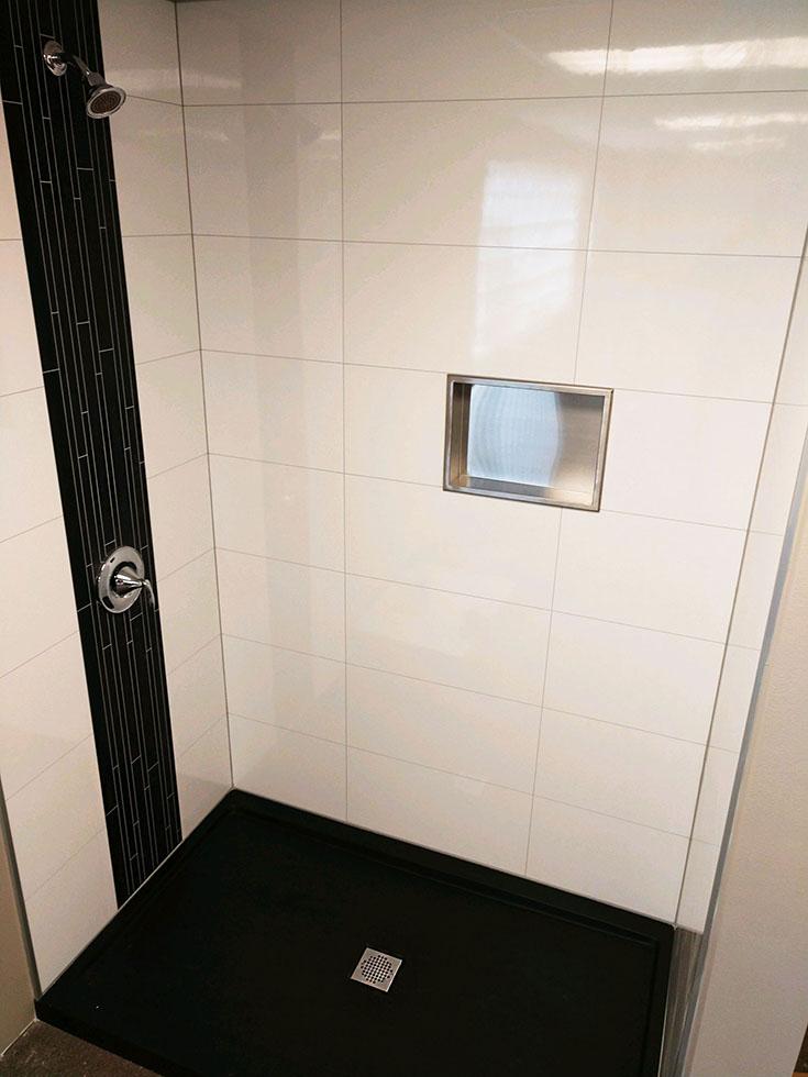 Laminate large format shower wall panels look like tile | Innovate Building Solutions | #bathroomremodel #diybathroom #showerremodelonabudget