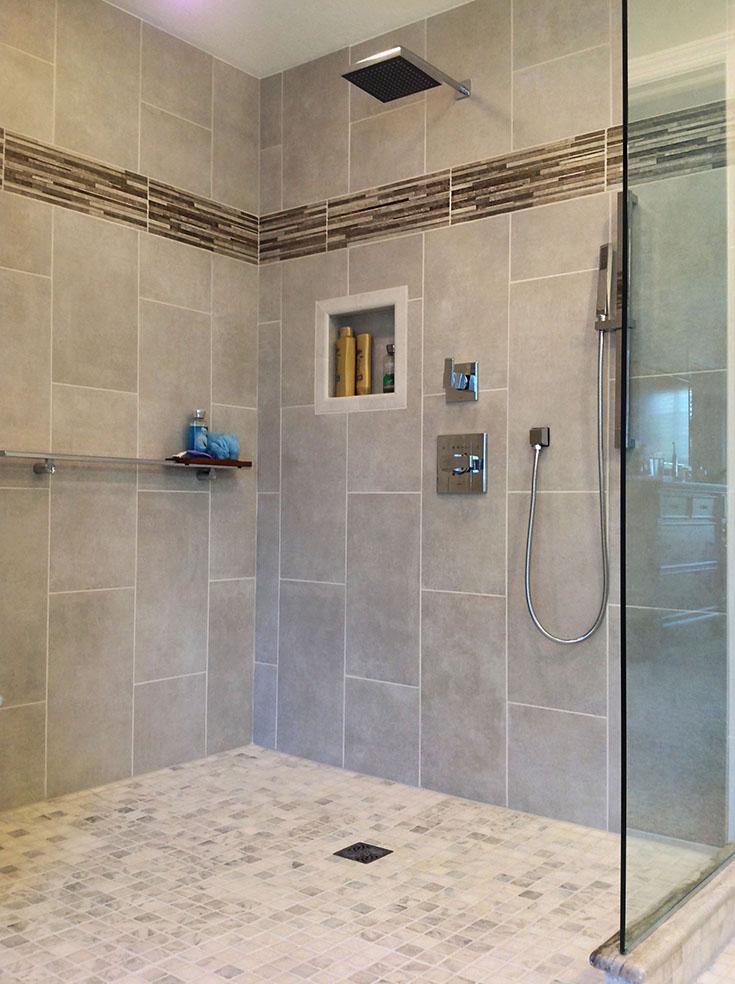 Tile vertical tile border in a wet room shower | Innovate Building Solutions | #verticaltiles #Tiledshower #bathroomremodel