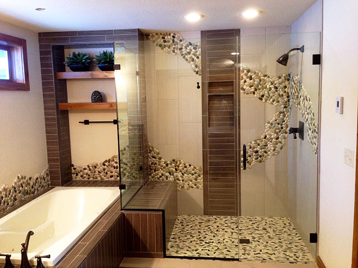 Tile wall patterns spill out into the room | Innovate Building Solutions | #TIledShower #BathroomRemodel #WallPatterns