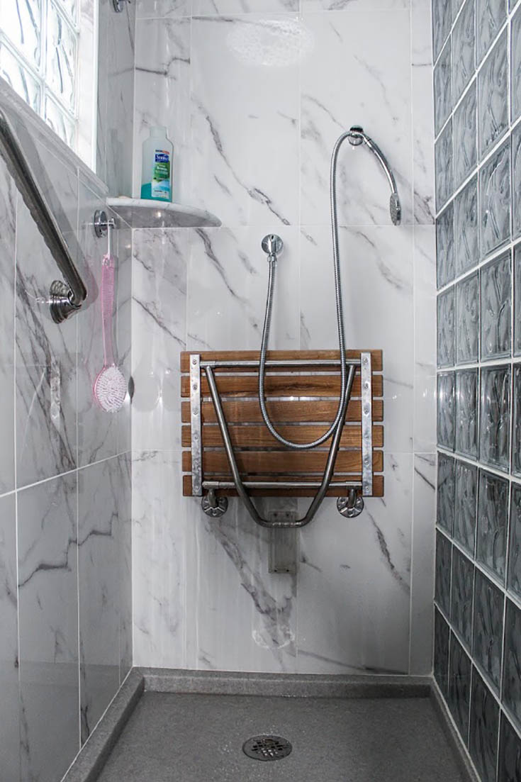 Custom cultured stone shower pan or base | Innovate Building Solutions | #CulturedStone #ShowerPan #GlassBlock