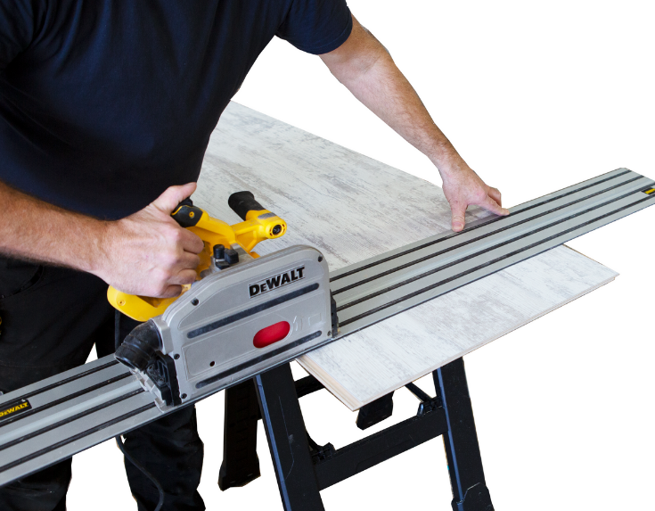 Cutting laminate wall panels with a tract saw | Innovate Building Solutions | #TractSaw #BathroomRemodeling #LaminateWallPanels #SimpleInstallation