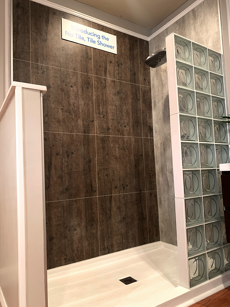 Modern glass block shower with rough wood pattern laminate grout free wall panels | Innovate Building Solutions | #GlassBlockWall #LaminateWallPanels #GlassBlockWall