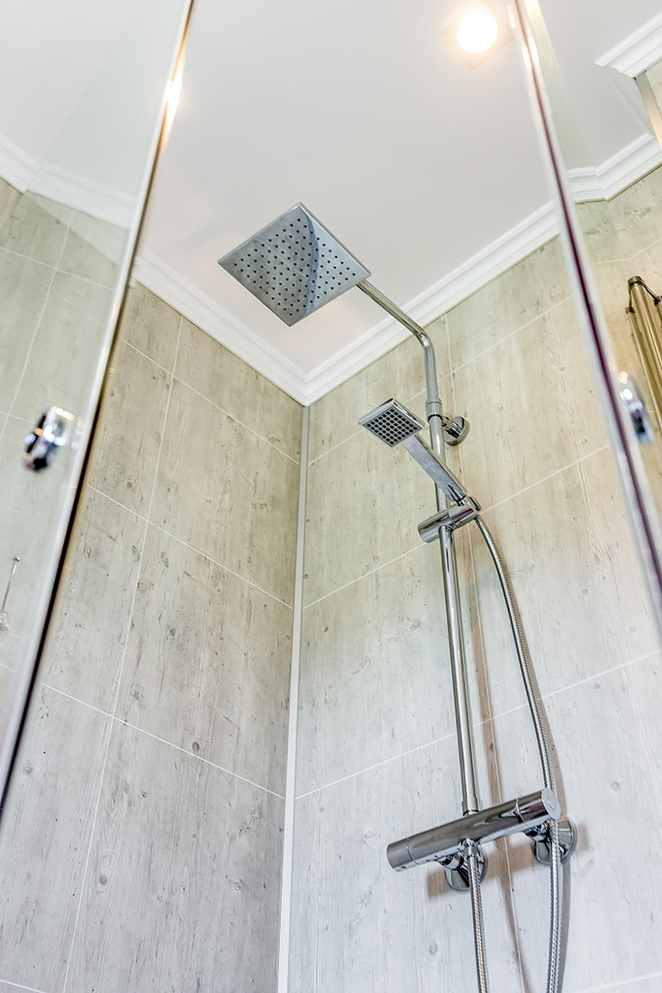 Rain shower head and laminate shower wall panels | Innovate Building Solutions | #ShowerHead #RainShower #BathroomRemodel #LaminateWallPanels