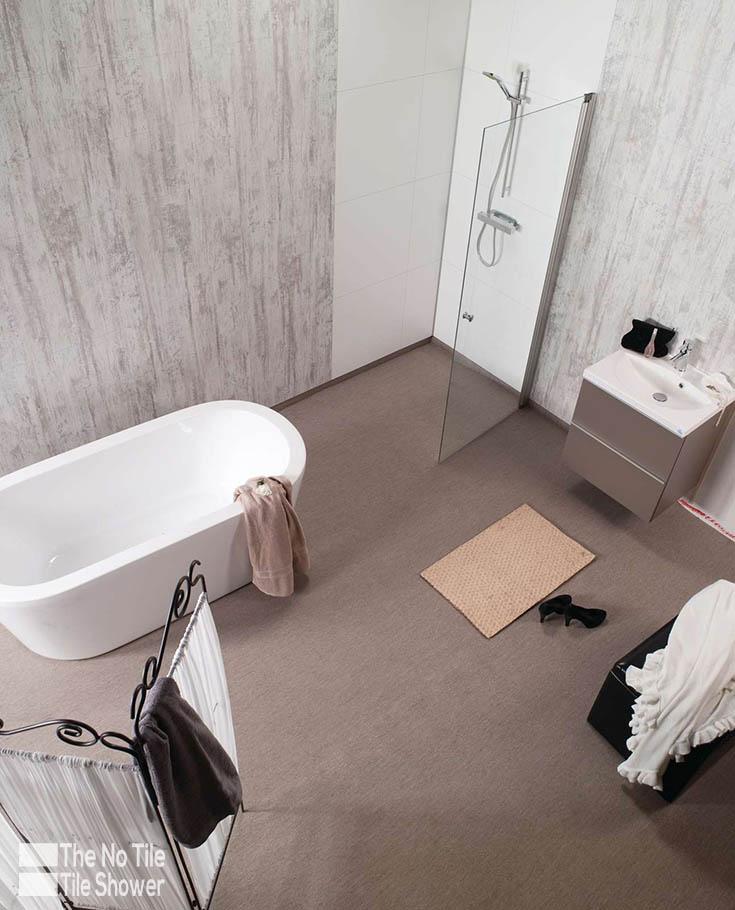 Waterproof shower wall panels in antique gray faux tile pattern | Innovate Building Solutions | #bathroomremodel #ShowerRemodel #Laminatewallpanels #TileShower