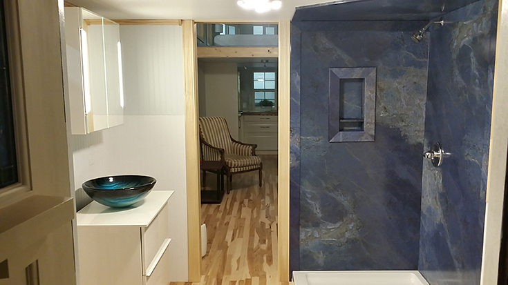 Blue marble PVC composite shower panels in a tiny home in North Carolina | innovate building solutions | #DIYwallpanels #PVCComposite #BlueMarblePanels