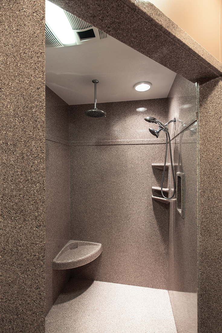 Cultured granite longer shower wall panels without seams | Innovate Building Solutions | #SolidSurface #WallPanels #culturedgranite #ShowerBase