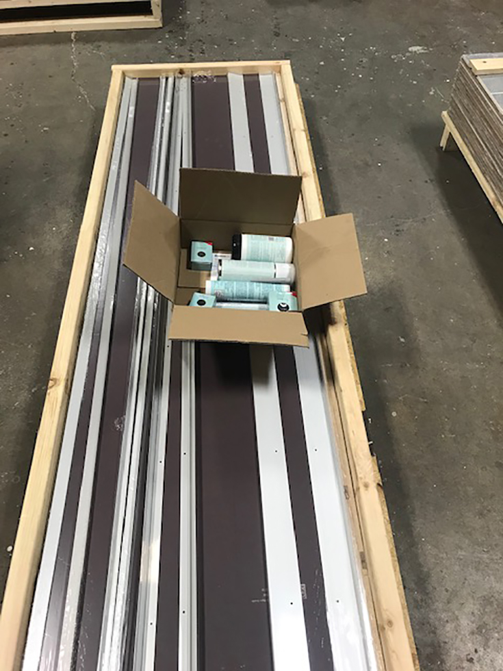 Laminate shower panels and trim pieces crated for shipment | Innovate Building Solutions | #Shipments #WallPanelsShipments #ShippingWallpanels
