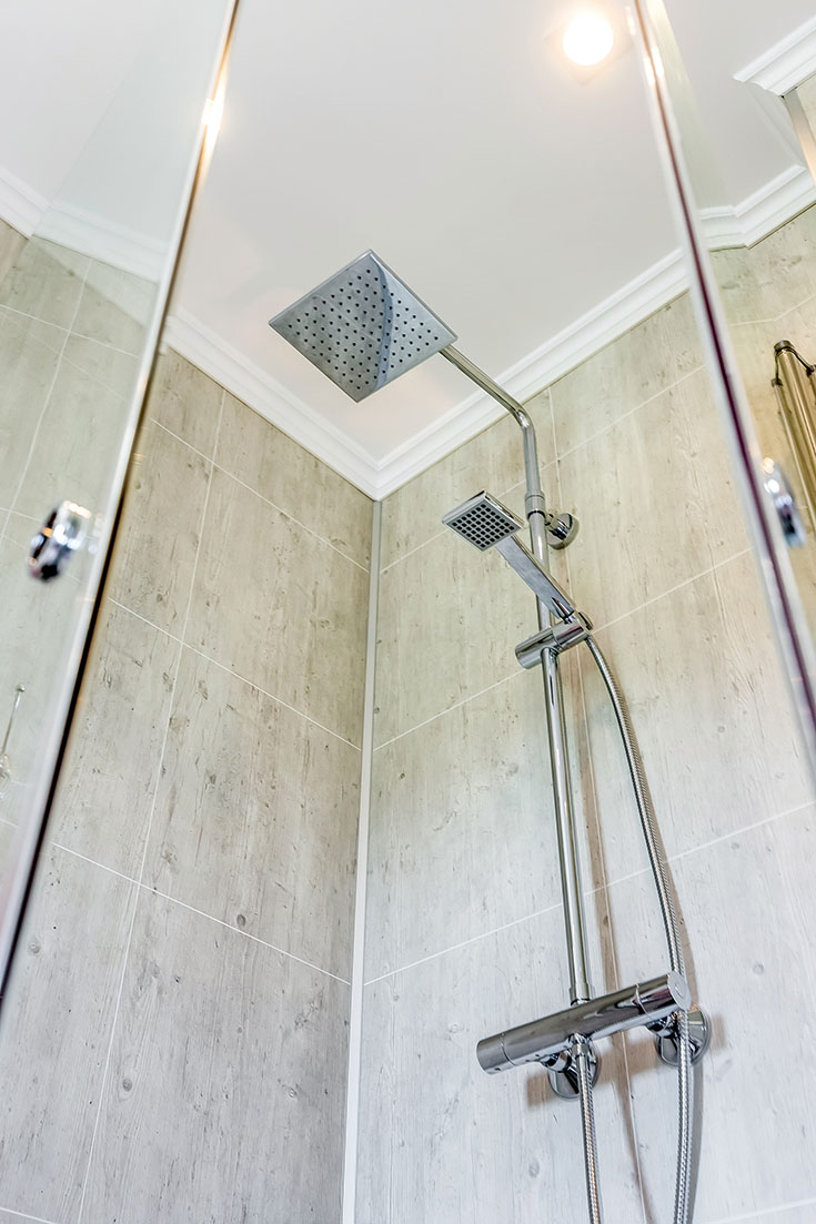 rain head with cracked cement laminate shower wall panels | Innovate Building Solutions | #LaminateWallPanels #CrackedCement #RainHead #ShowerRainHead