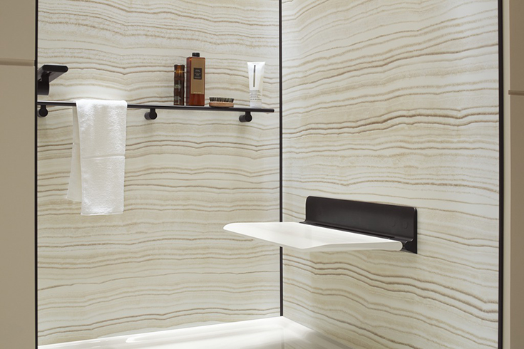 fold down seat for a multi generational shower and bathroom | Innovate Building Solutions | #FolddownSeat #bathroomremodel #Handicapshower