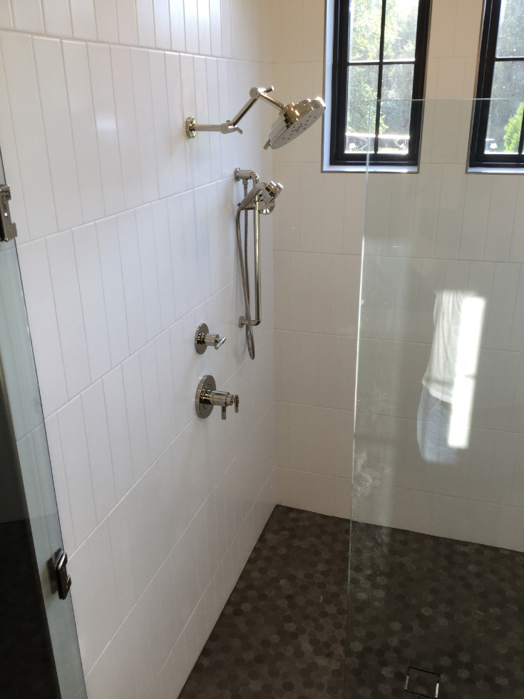 matte black transom windows in an upscale shower Columbus Ohio | Innovate Building Solutions | #transomwindow #bathroomwindow #showerwindow