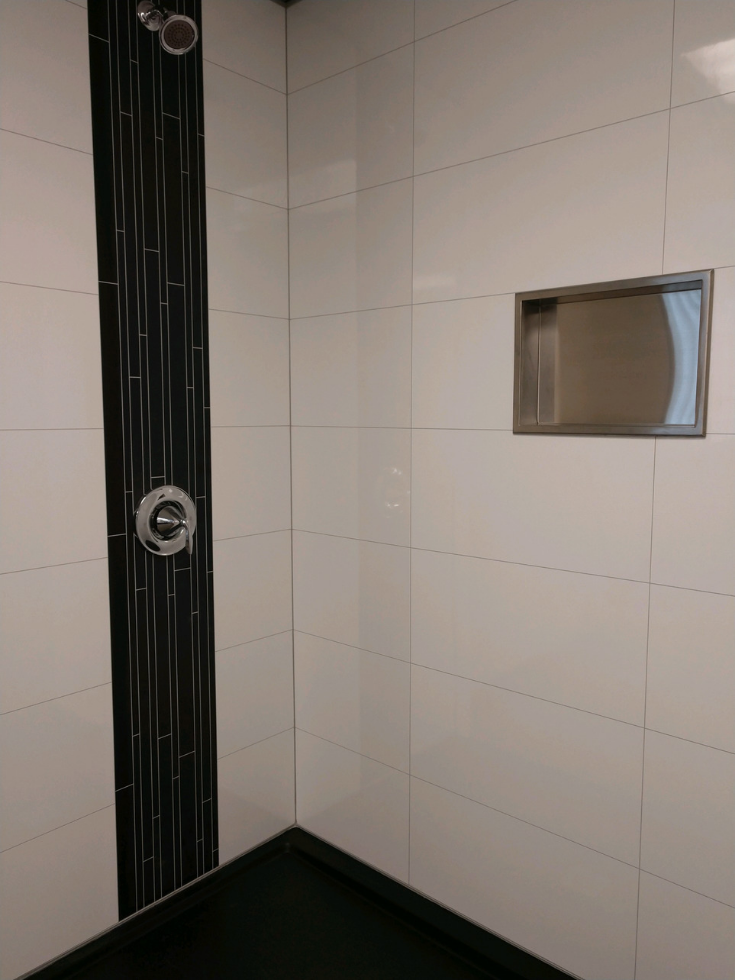 Brushed nickel recessed niche in a grout tile free shower | Innovate Building Solutions | #Laminatewallpanels #RecessedNiche #GroutFreePanels