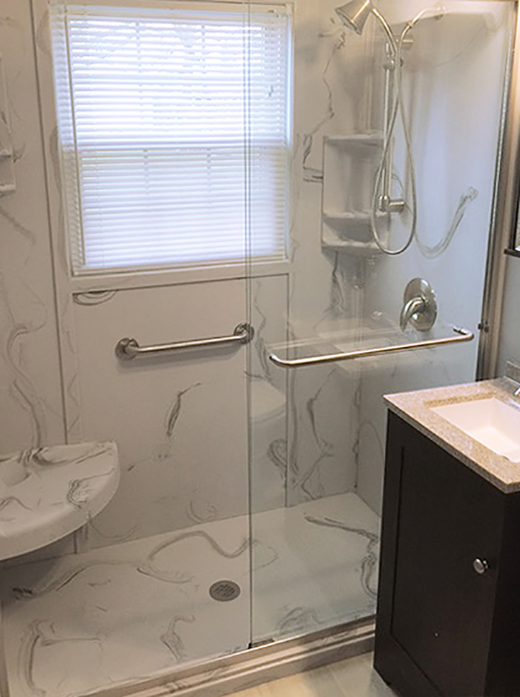 Gray and white swirl custom cultured stone shower base | Innovate Building Solutions | #CustomBase #ShowerPan #CulturedStone #GrayandwhiteshowerBase