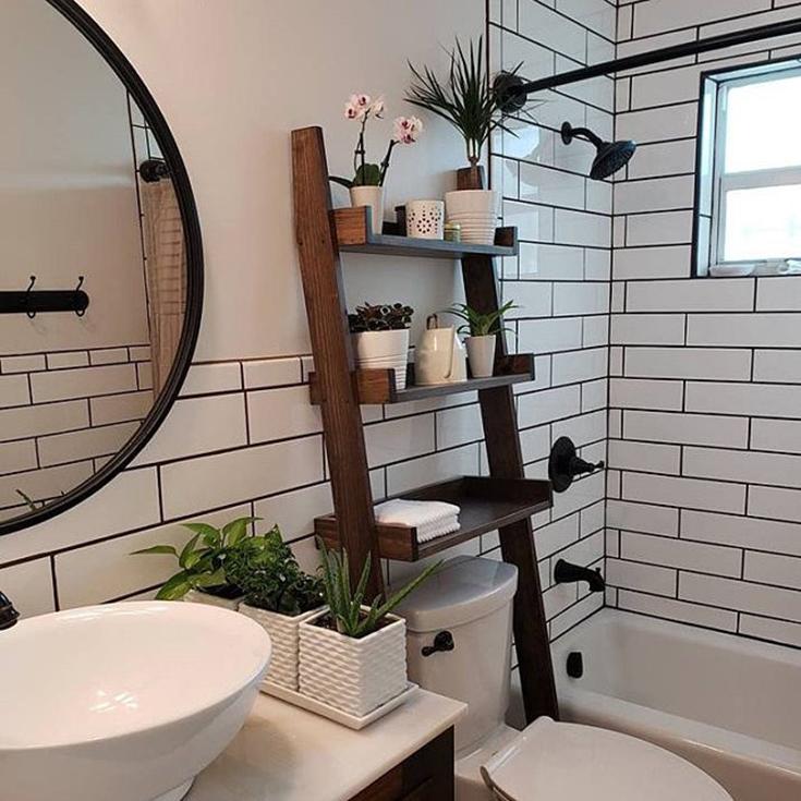 Ladder style storage rack credit Blackberry Woodshop | Innovate Building Solutions | #LadderStorageRack #StorageRack #BathroomDesign