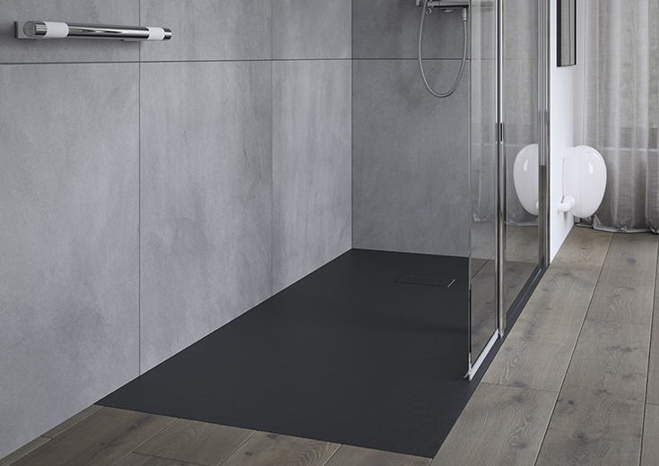 Matte black tileless one level wet room system | Innovate Building Solutions | #WalkInShower #RollInshower #OneLevelshower #OneLevelWetRoom