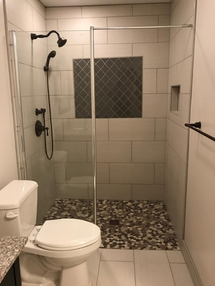 One level shower wet room in a 5' x 8' bathroom | Innovate Building Solutions | #Onelevelshower #WetRoom #TileShower #RollInShower