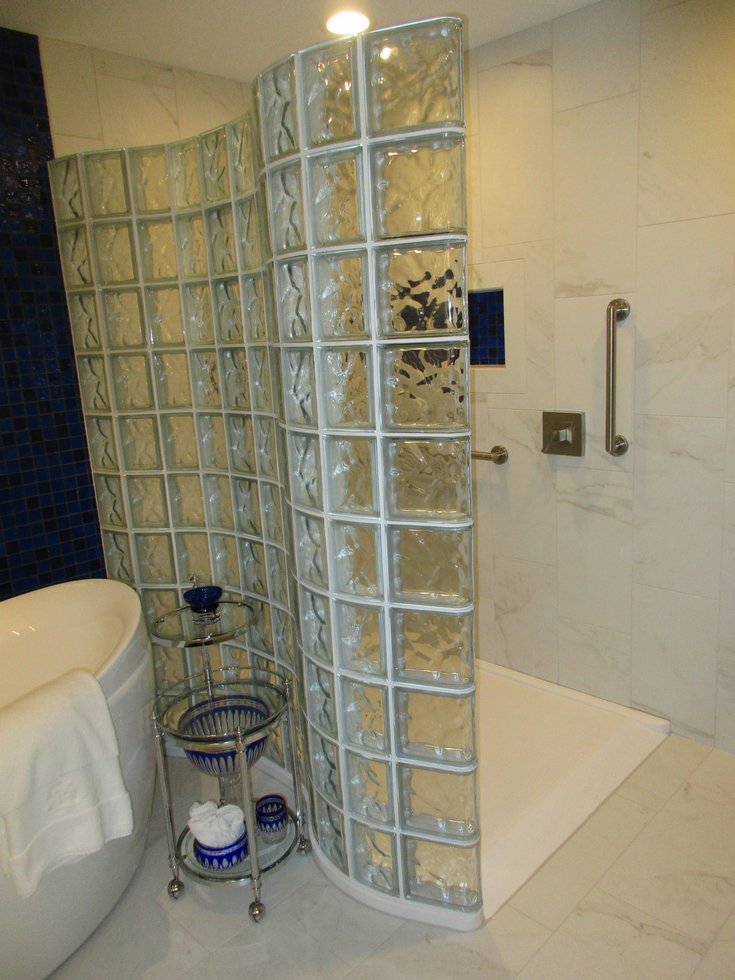 Ramped zero threshold cultured granite shower pan | Innovate Building Solutions | #granitebase #Culturedgranite #ShowerPan #RampedShower