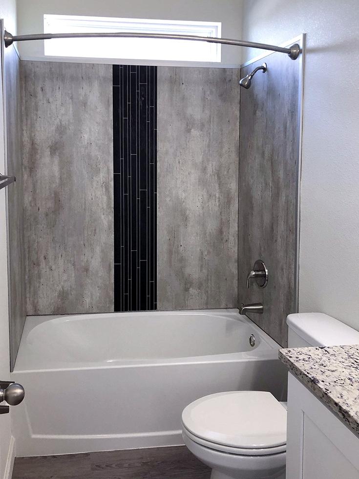 Laminate waterproof bathtub surround | Innovate Building Solutions | #Laminatewallpanels #WaterproofShower #BathtubSurround