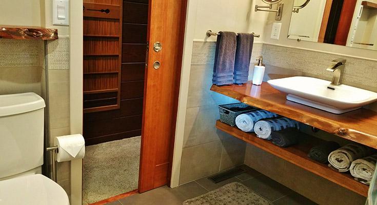 live edge urethaned bath vanity countertop | Innovate Building Solutions | #VanityTop #Countertop #UrethanedBathVanity