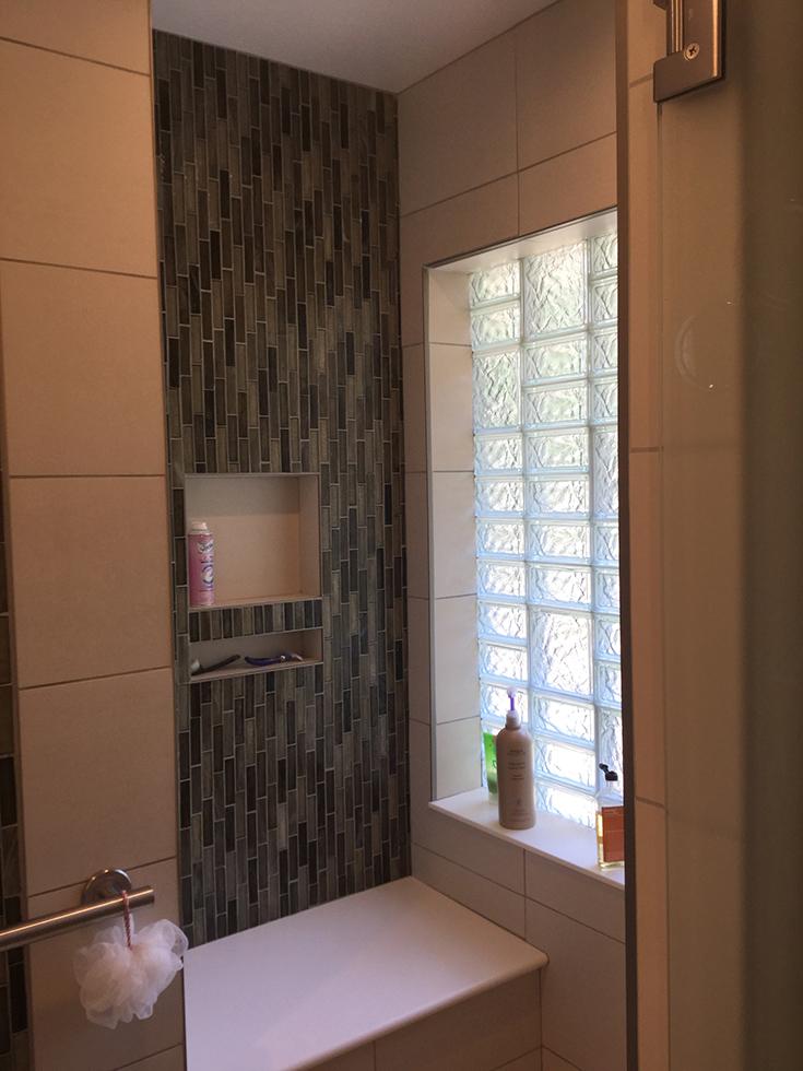 multi patterned glass block shower window | Innovate Building Solutions | #GlassBlock #GlassBlockShower #MultiPatternGlassBlock