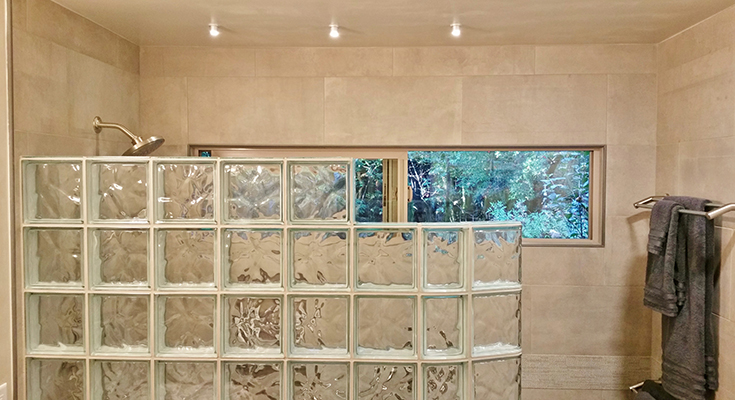 transom window and curved glass block shower wall | Innovate Building Solutions | #CurvedGlassBlock #TransomWindow #ShowerWindow