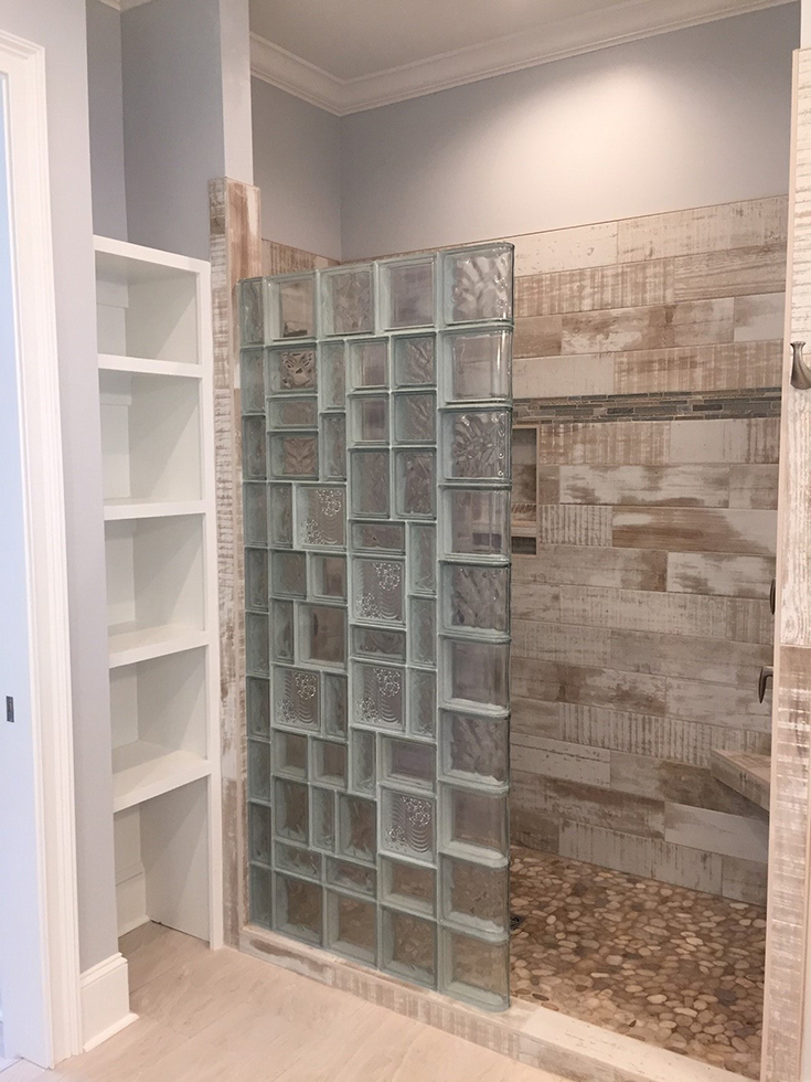 Thin line series glass block wall with multi patterns in a walk in design | Innovate Building Solutions
