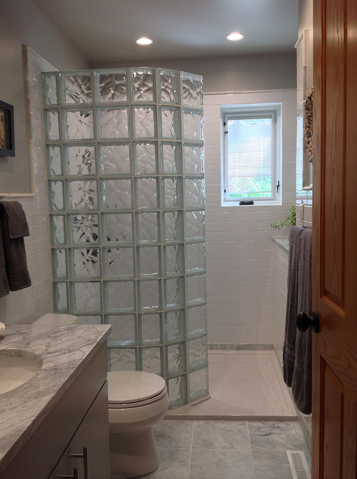 Curved glass block shower and a high gloss cultured granite shower base | Innovate Building Solutions | #GlassBlockWall #GlassBlockDesign #ShowerWall