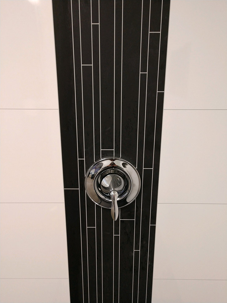 They're realistic close up laminate shower wall | Innovate Building Solutions | #DecorativeAccent #WallPanels #Showerwallpanels