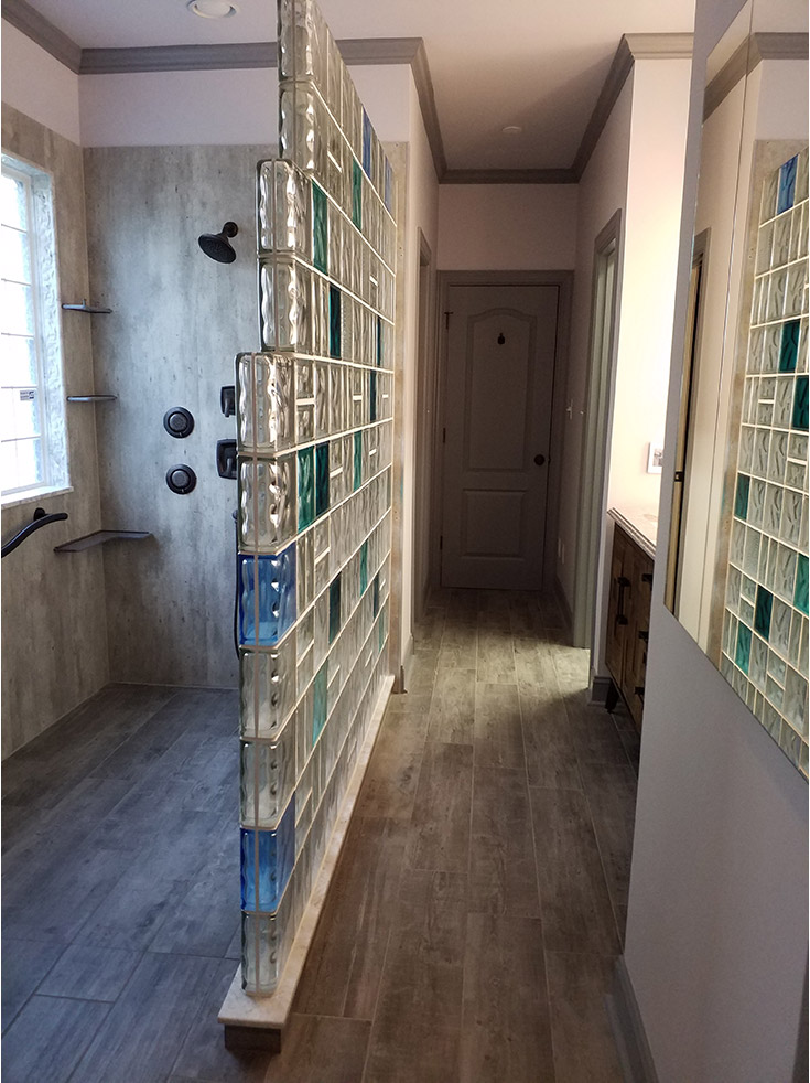 Cracked cement simple to install laminate shower panels in a roll in shower | Innovate Building Solutions | #GlassBlockShower #WalkInShower #ColorGlassBlock