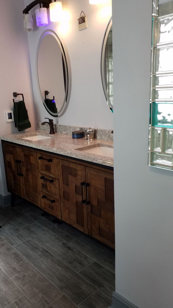 Furniture grade vanity in a custom bath remodel in North Carolina | Innovate Building Solutions | #Vanity #CustomBathRemodel #NorthCarolinaBathroom