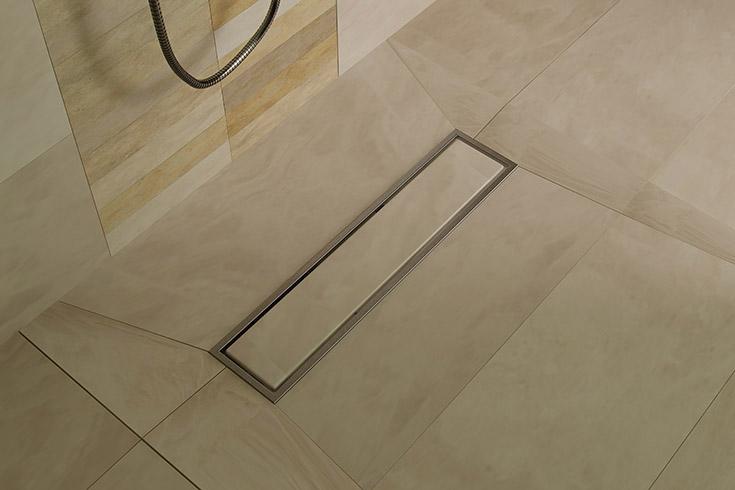 Large format custom tile shower floor pan | Innovate Building Solutions | #SolidSurface #LinearDrain #ShowerFloor #TileShower