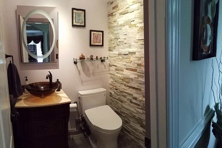 Toto toilet and stone wall in a water closet in North Carolina remodel | Innovate Building Solutions | #ToToToilet #StoneWall #BathroomRemodel
