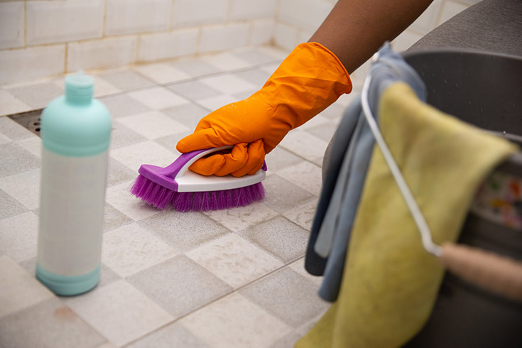 cleaning tile grout joints on a shower pan floor | Innovate Building Solutions | #cleaninggrout #TileShower #ShowerPan #GroutJoints