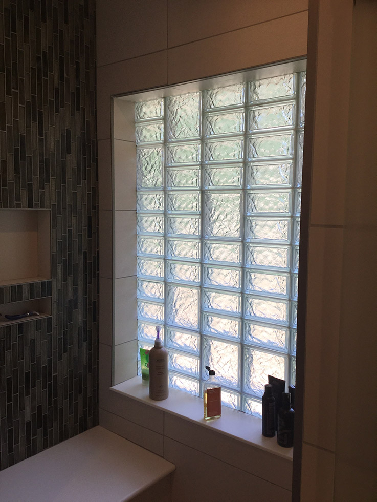 glass block high privacy shower window with different sized blocks | Innovate Building Solutions | #GlassBlockWindow #ObscureGlass #PrivacyGlass #BathroomWindow