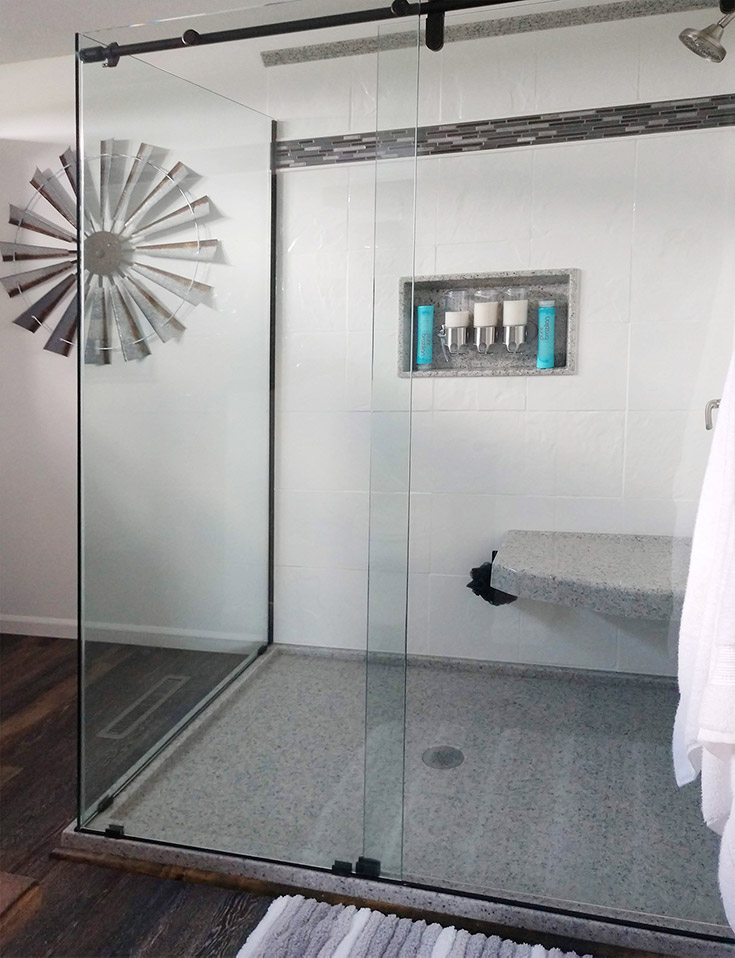 stone shower pan in a bathroom remodel | Innovate Building Solutions | #CulturedStone #ShowerPan #CustomShowerBase