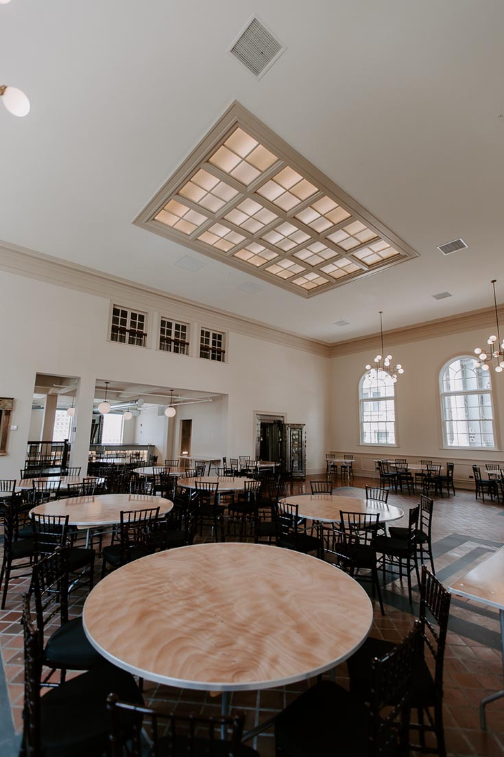 Fashionable dining and event room vaulted ceiling skylights palladium windows | Innovate Building Solutions | Skylights #VaultedCeiling DinningArea