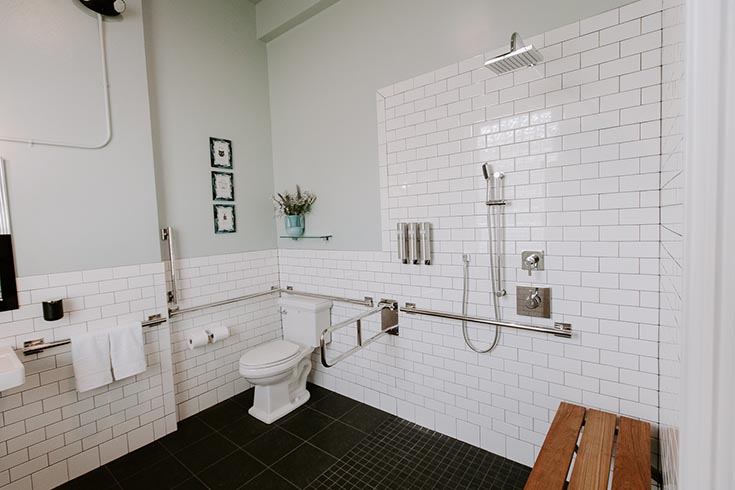 Functional ADA shower wtih subway tile in The Bank East Aurora New York | #ADAShower #RollinShower #AirBNB