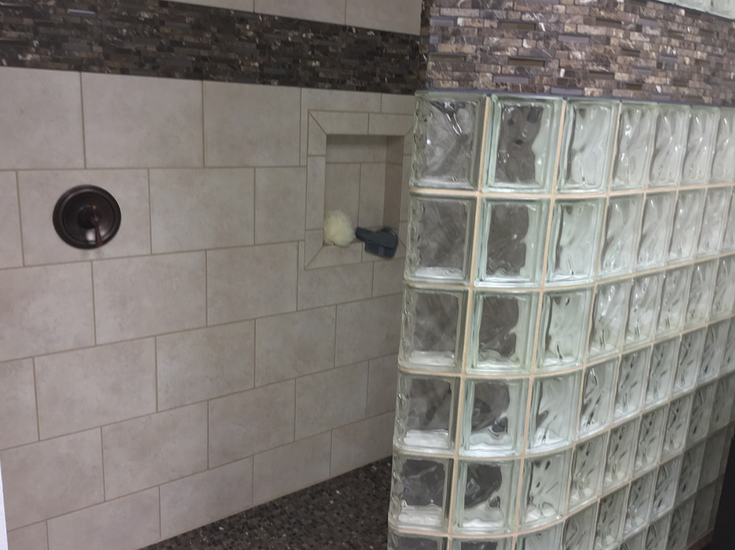 Shower valve by opening in a walk in glass block curved shower | Innovate Building Solutions | #Glassblockshower #GlassShowerwall #WalkInShower