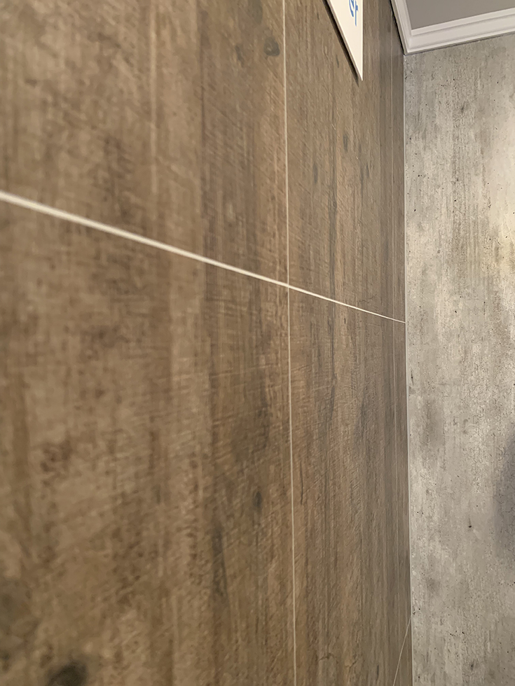 rough wood and cracked cement organic laminate shower wall panels | Innovate Building Solutions | #CrackedCement #WallPanels #LaminateShower