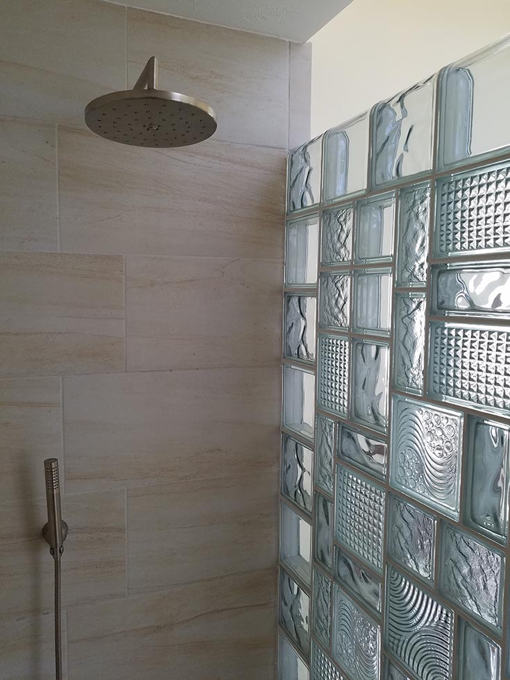 stained glass look in a glass block multi size pattern wall | Innovate Building Solutions | #GlassBlock #GlassBlockWall #ShowerWall