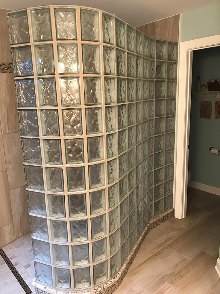 Detail 3 curved glass block shower and a ready for tile shower pan | Innovate Building Solutions | #GlassBlockShower #GlassBlockWall #ShowerWall