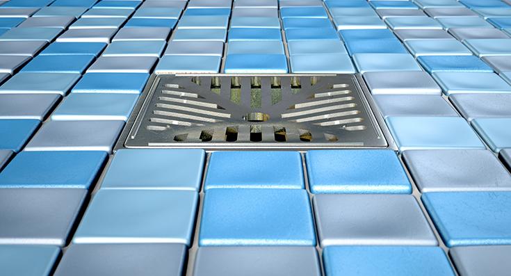 Advantage 4 drain location in a ceramic tile shower | Innovate Building Solutions | #CeramicTile #TileShower #BathroomRemodel