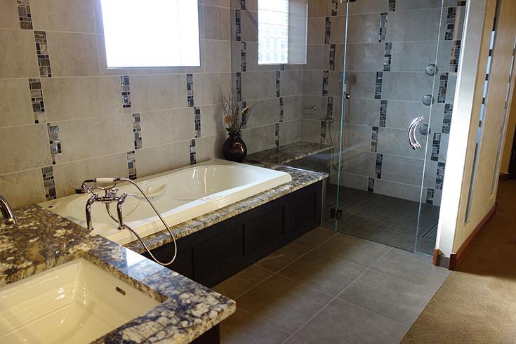 Factor 3 roll in shower with large pivoting glass door and a wet room system | Innovate building Solutions | #ClevelandRemodel #BathroomRemodel BathDoctor #Showerdoor